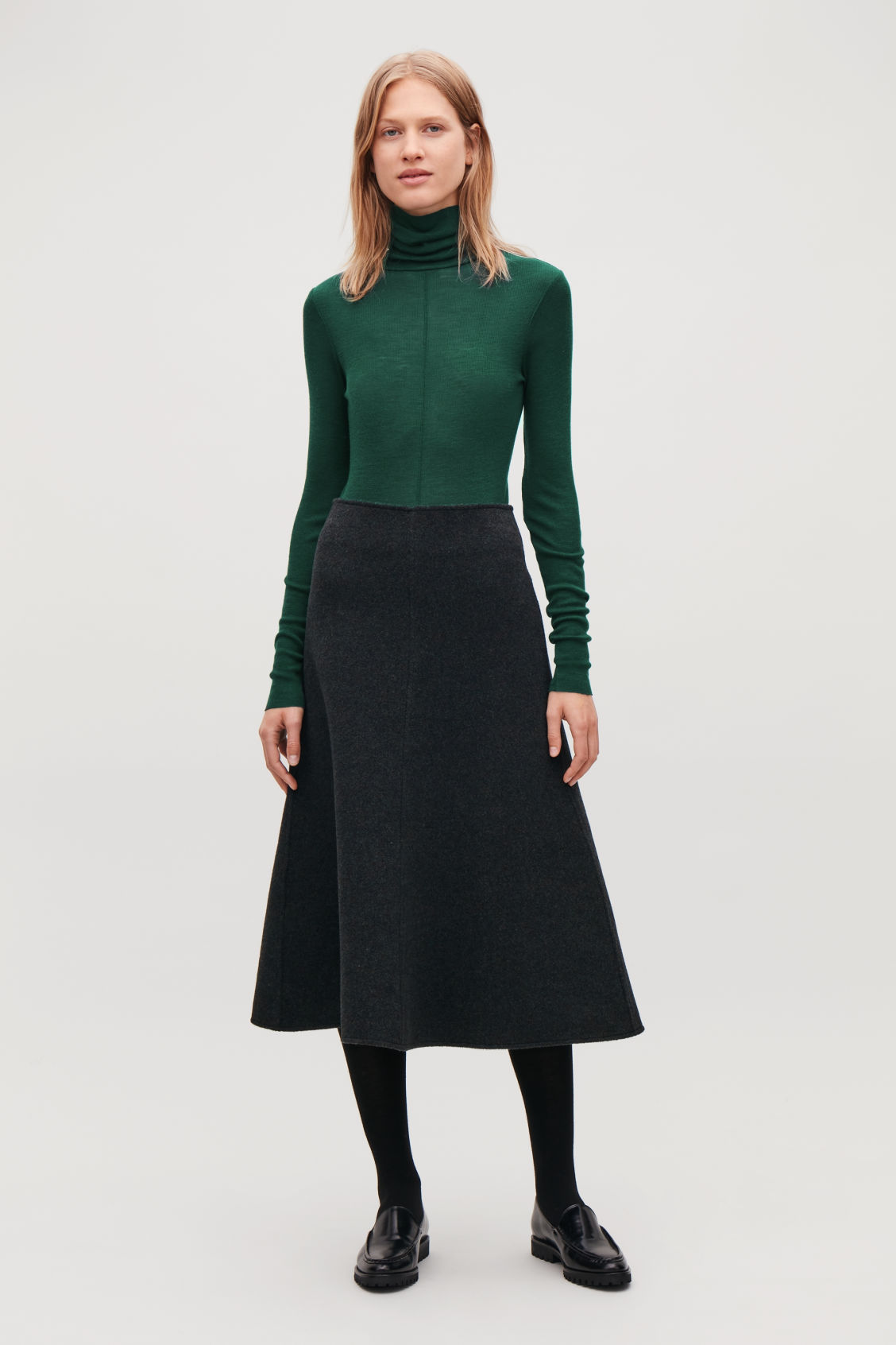 Model front image of Cos ribbed jersey high-neck top in green