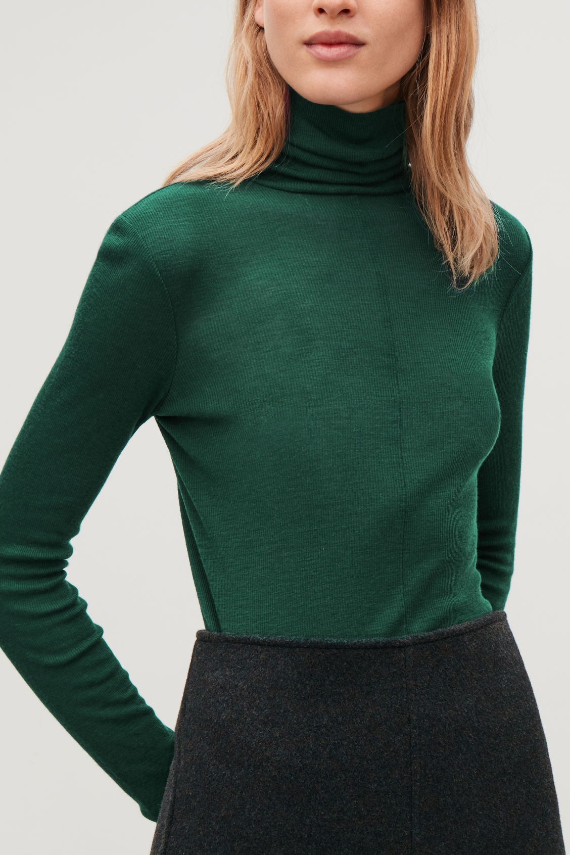 Model side image of Cos ribbed jersey high-neck top in green