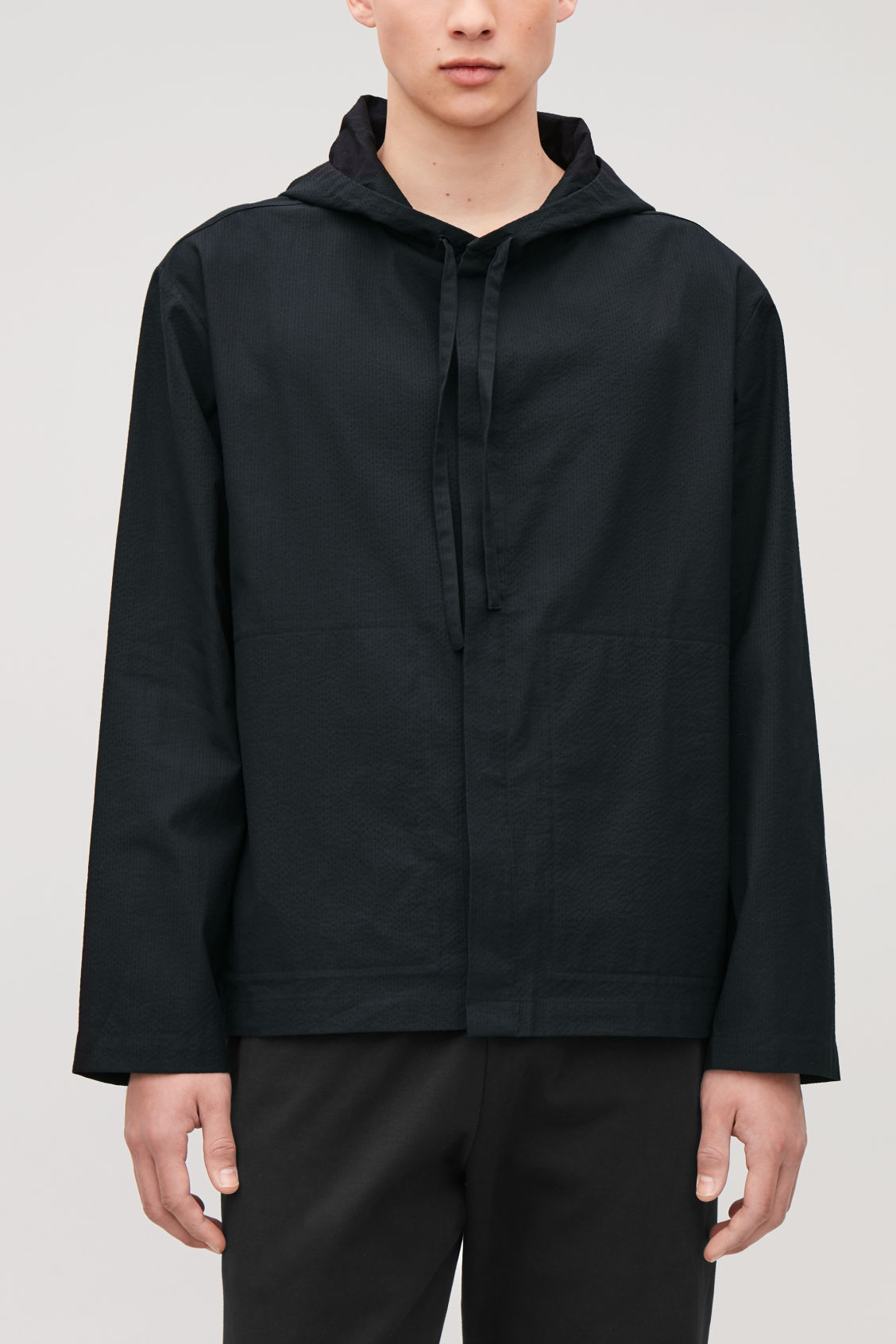 Model side image of Cos lightweight hooded jacket  in blue