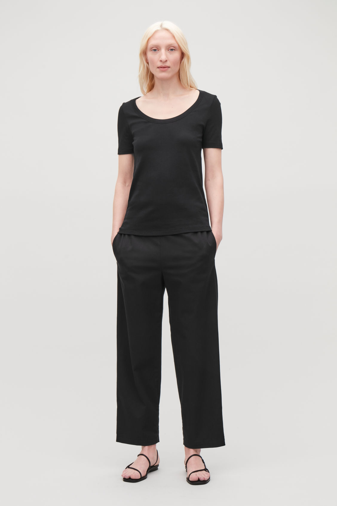 Model front image of Cos deep round-neck cotton top  in black