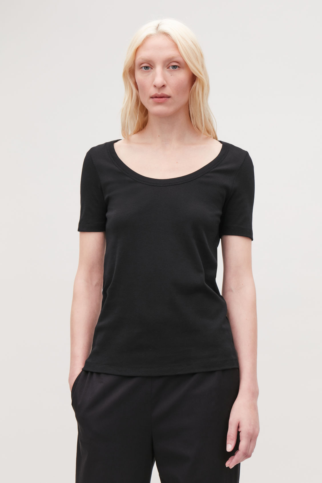 Model side image of Cos deep round-neck cotton top  in black