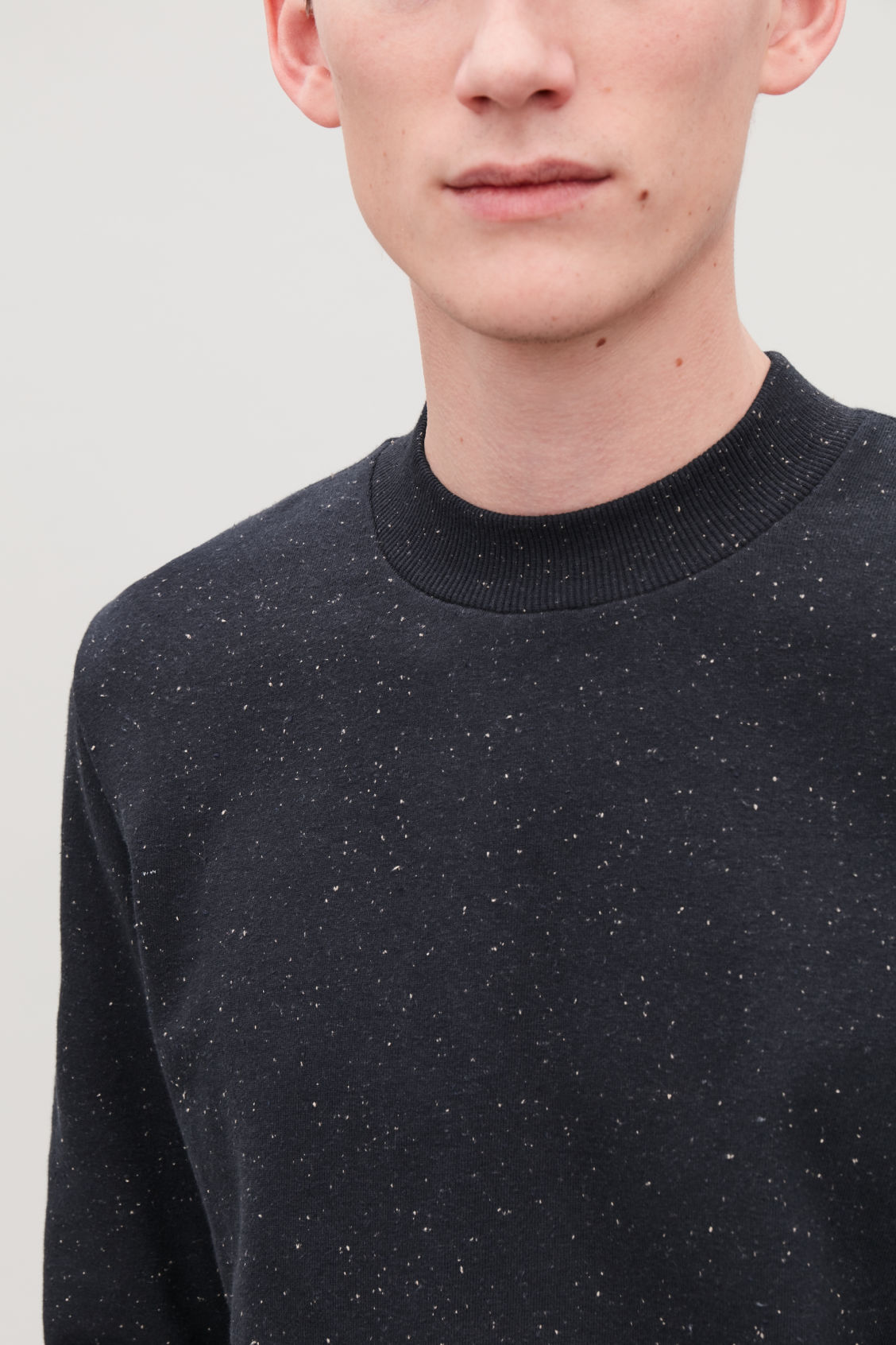 Model side image of Cos speckled jersey jumper  in blue