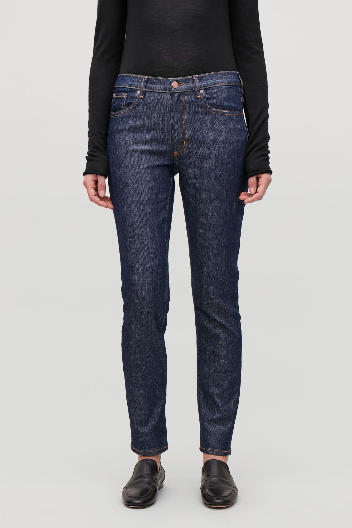 Model side image of Cos skinny-leg jeans in blue