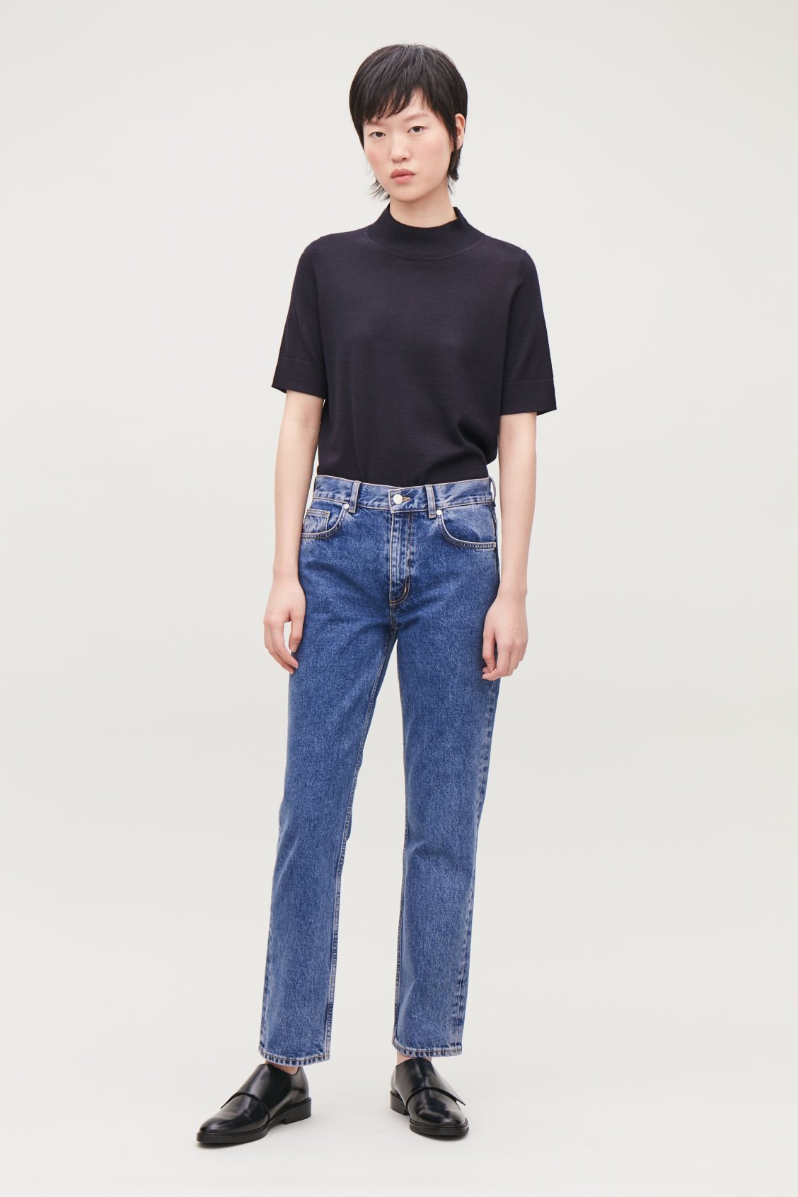 Model front image of Cos slim leg jeans in blue