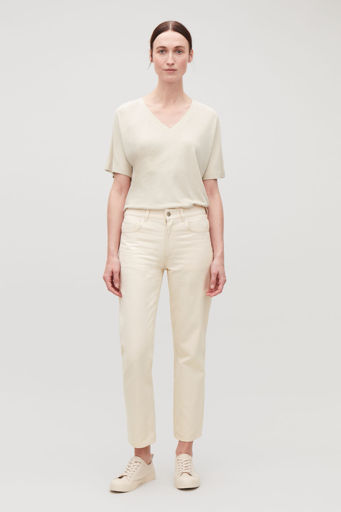 Model front image of Cos slim leg jeans in cream