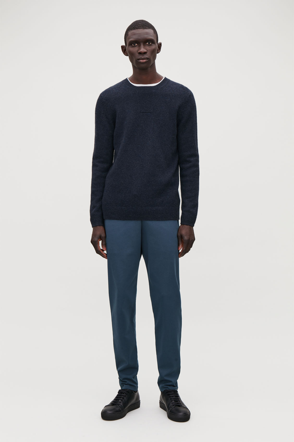 Model front image of Cos cotton jogging trousers in blue