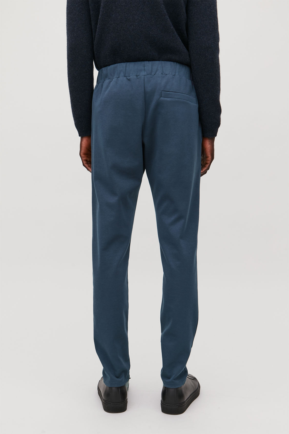 Model side image of Cos cotton jogging trousers in blue