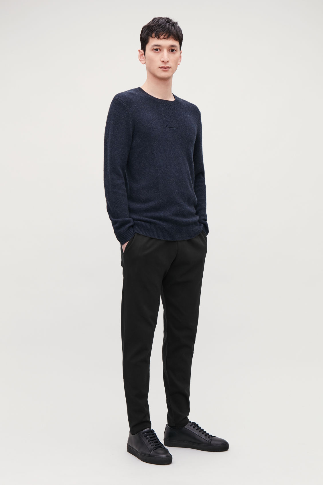 Model front image of Cos cotton jogging trousers in black