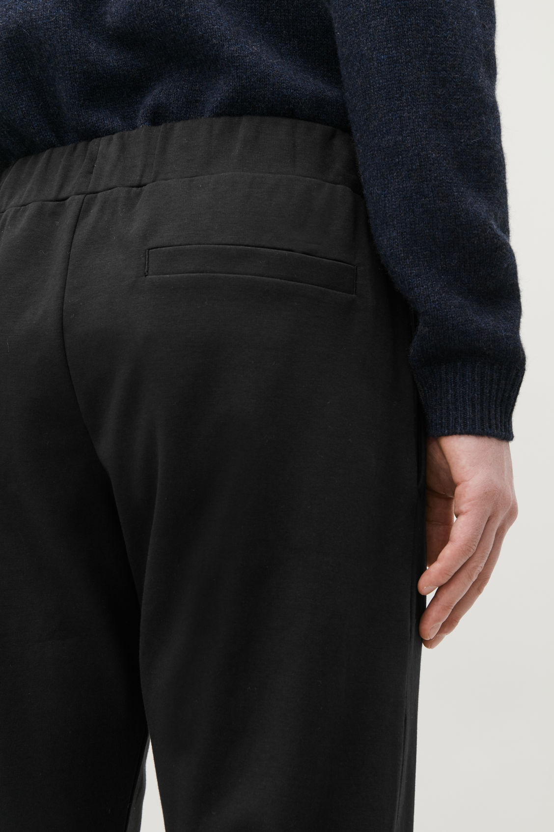 Model side image of Cos cotton jogging trousers in black
