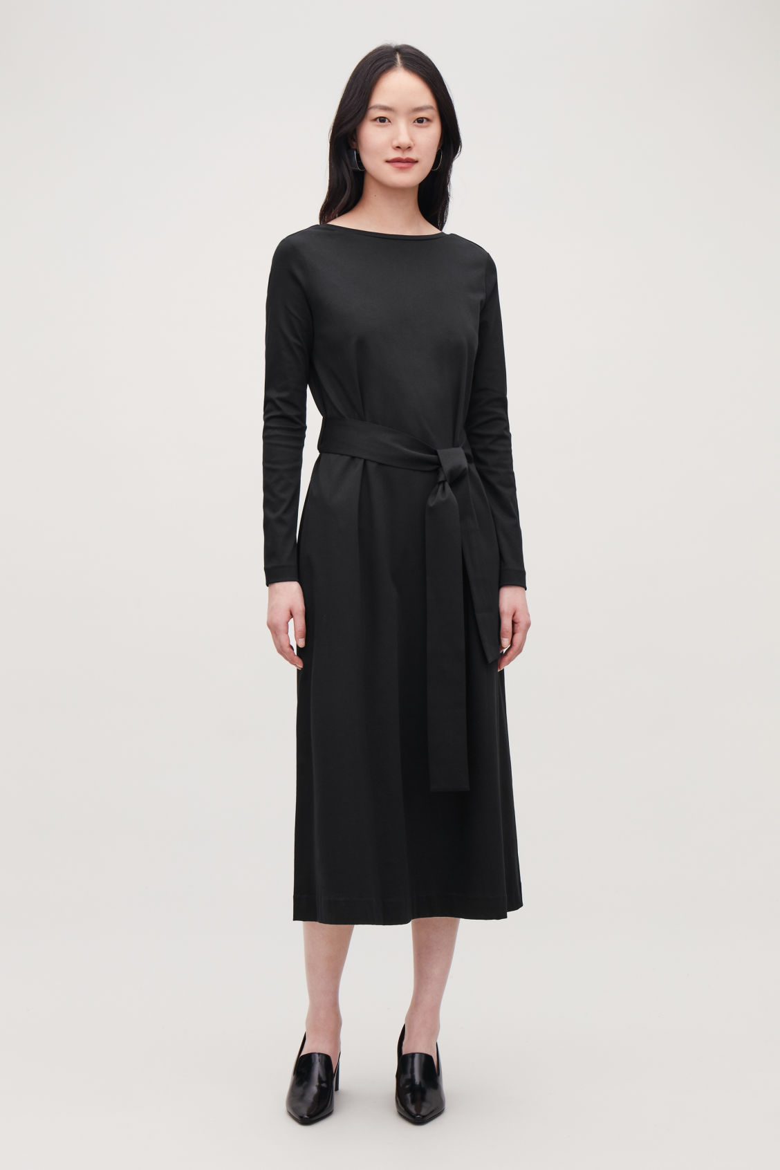 Model front image of Cos belted long jersey dress in black
