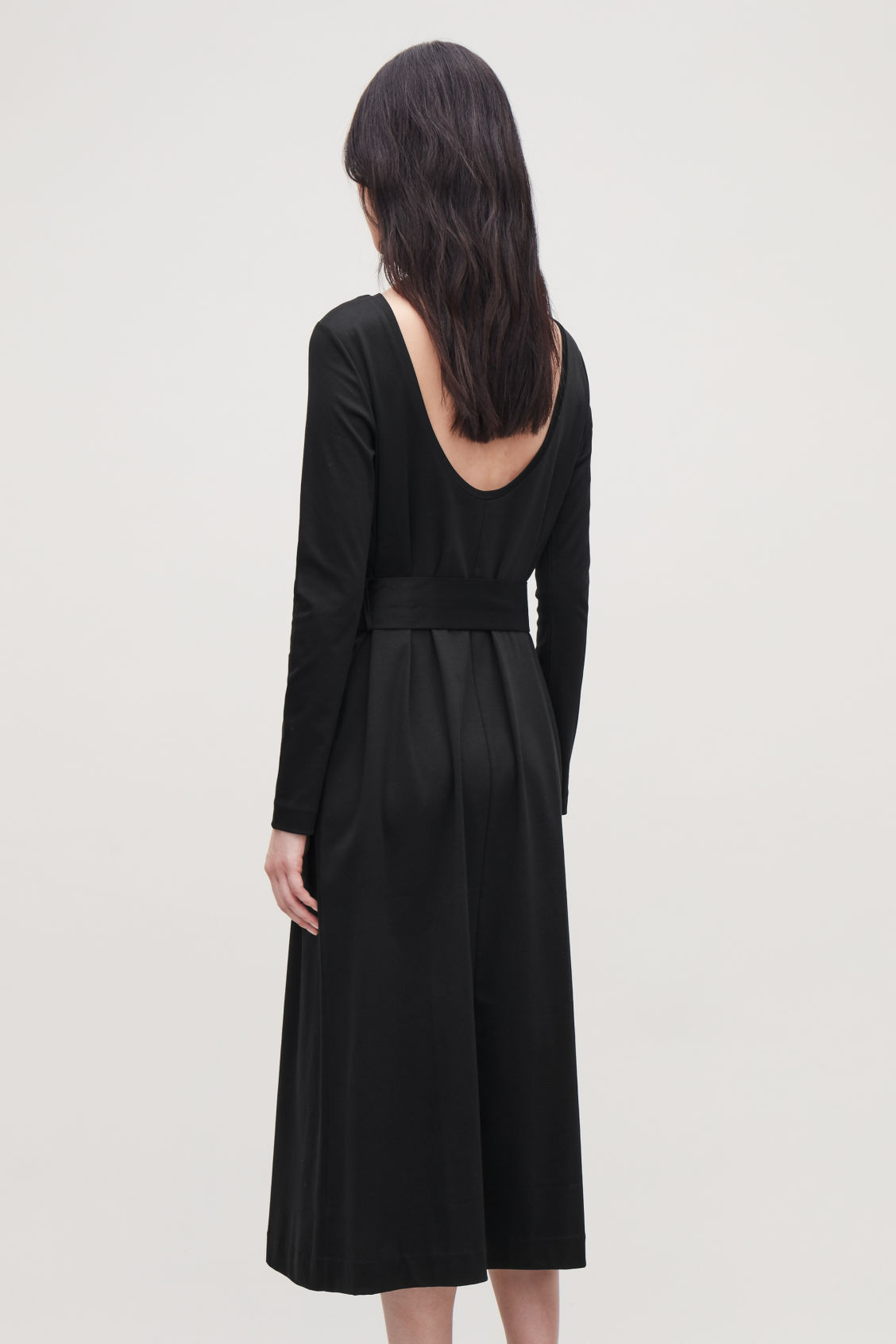 Model side image of Cos belted long jersey dress in black