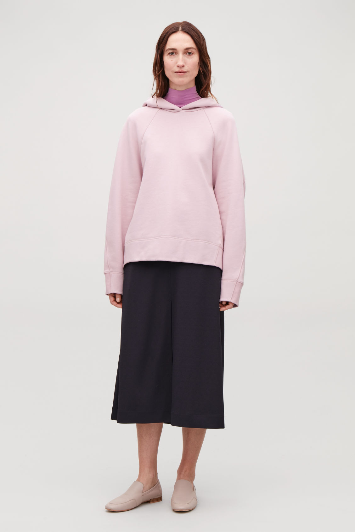 Model front image of Cos hooded sweatshirt with wrap seams in pink