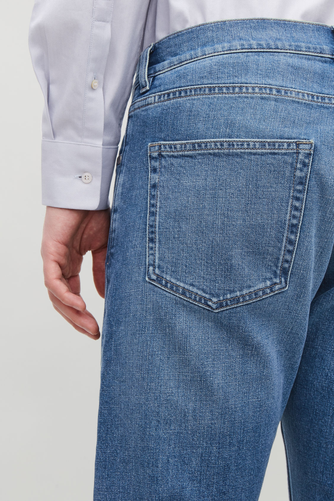 Model side image of Cos slim leg jeans in blue