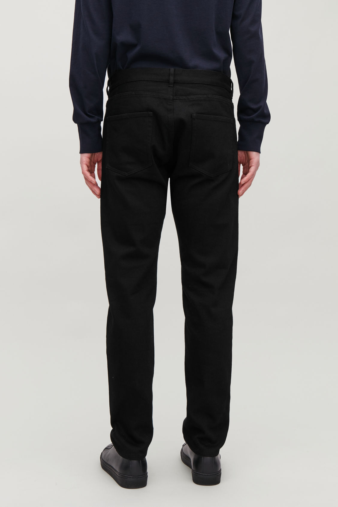 Model side image of Cos slim-leg jeans in black