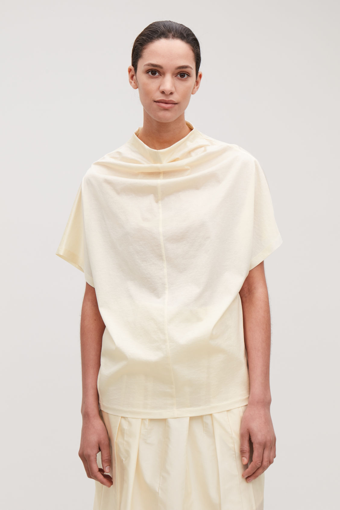 Model side image of Cos draped-neck cotton t-shirt in yellow