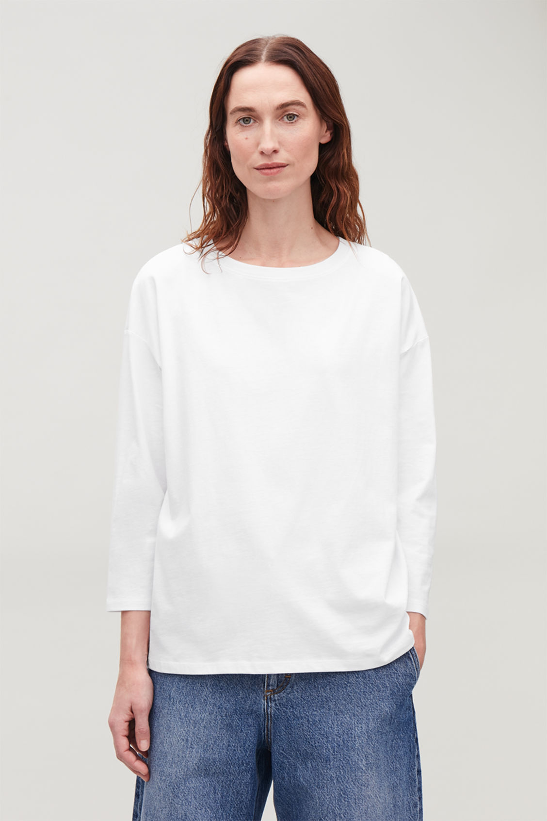 Model side image of Cos boxy long-sleeved cotton top  in white