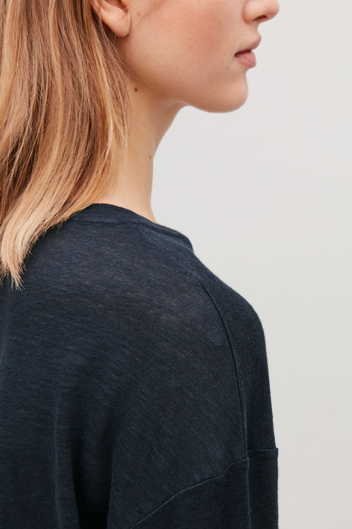 Model side image of Cos boxy linen-jersey top in blue