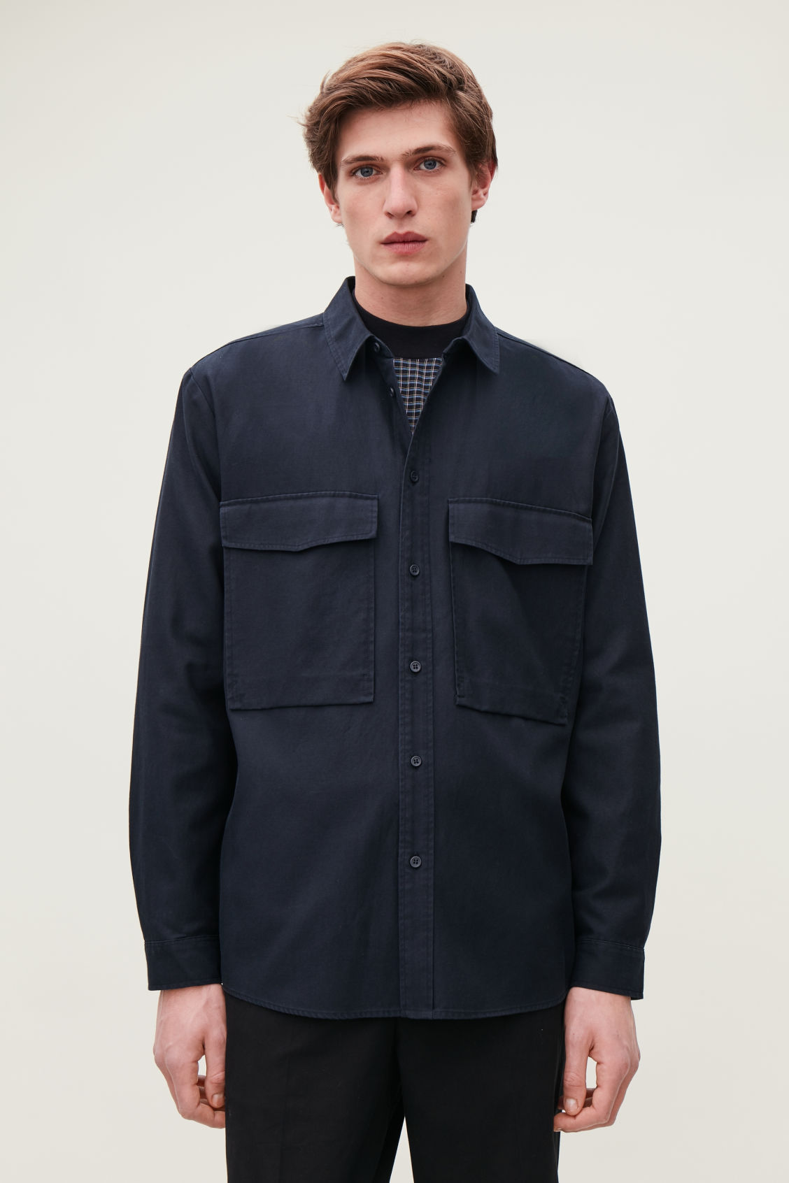 Model side image of Cos relaxed two-pocket shirt in blue