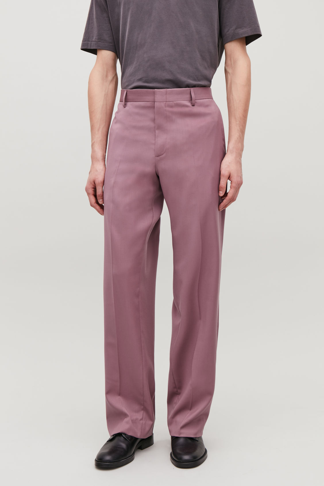 Model side image of Cos relaxed tailored trousers in purple