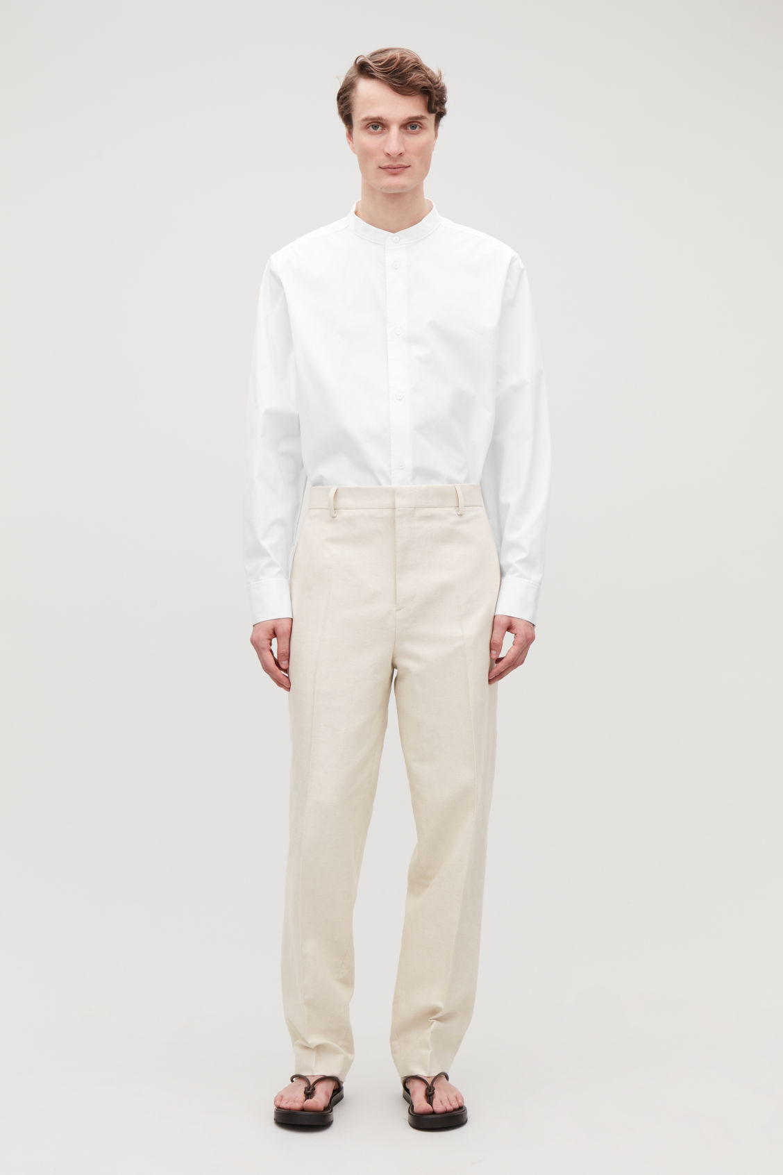 Model front image of Cos straight-leg linen trousers in beige