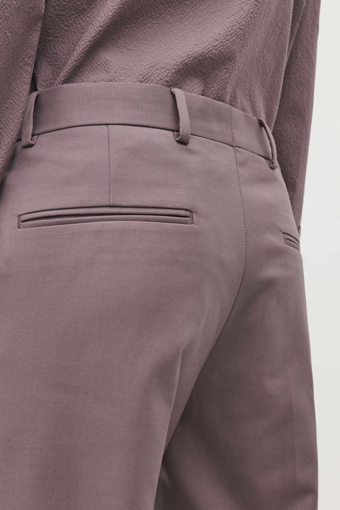 Model side image of Cos skinny-leg turn-up trousers in purple