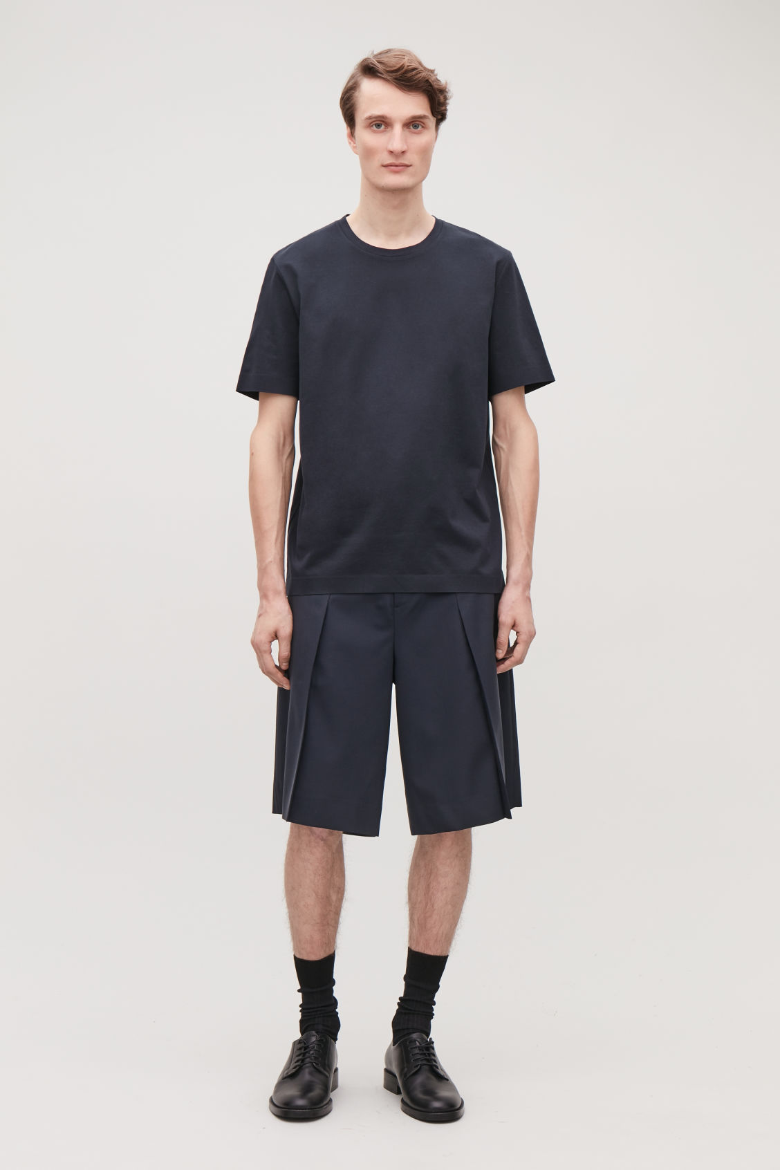 Model front image of Cos pleated tailored shorts in blue