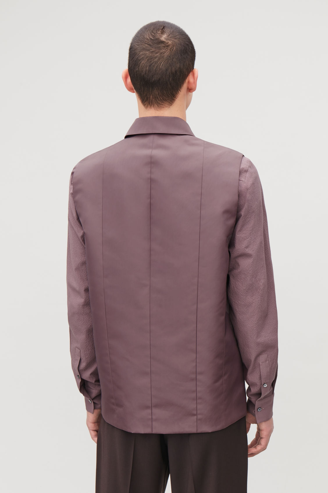 Model side image of Cos panelled sleeveless jacket in purple