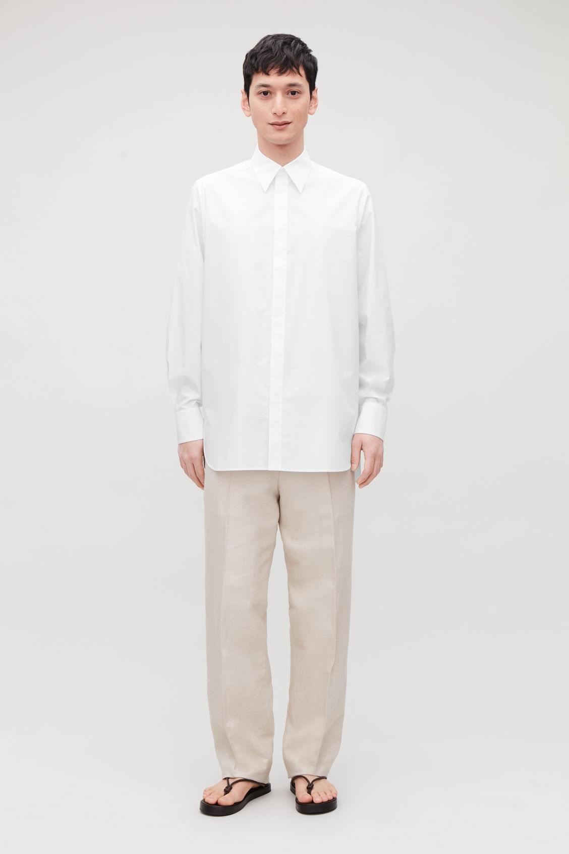 Model front image of Cos concealed-button cotton shirt in white