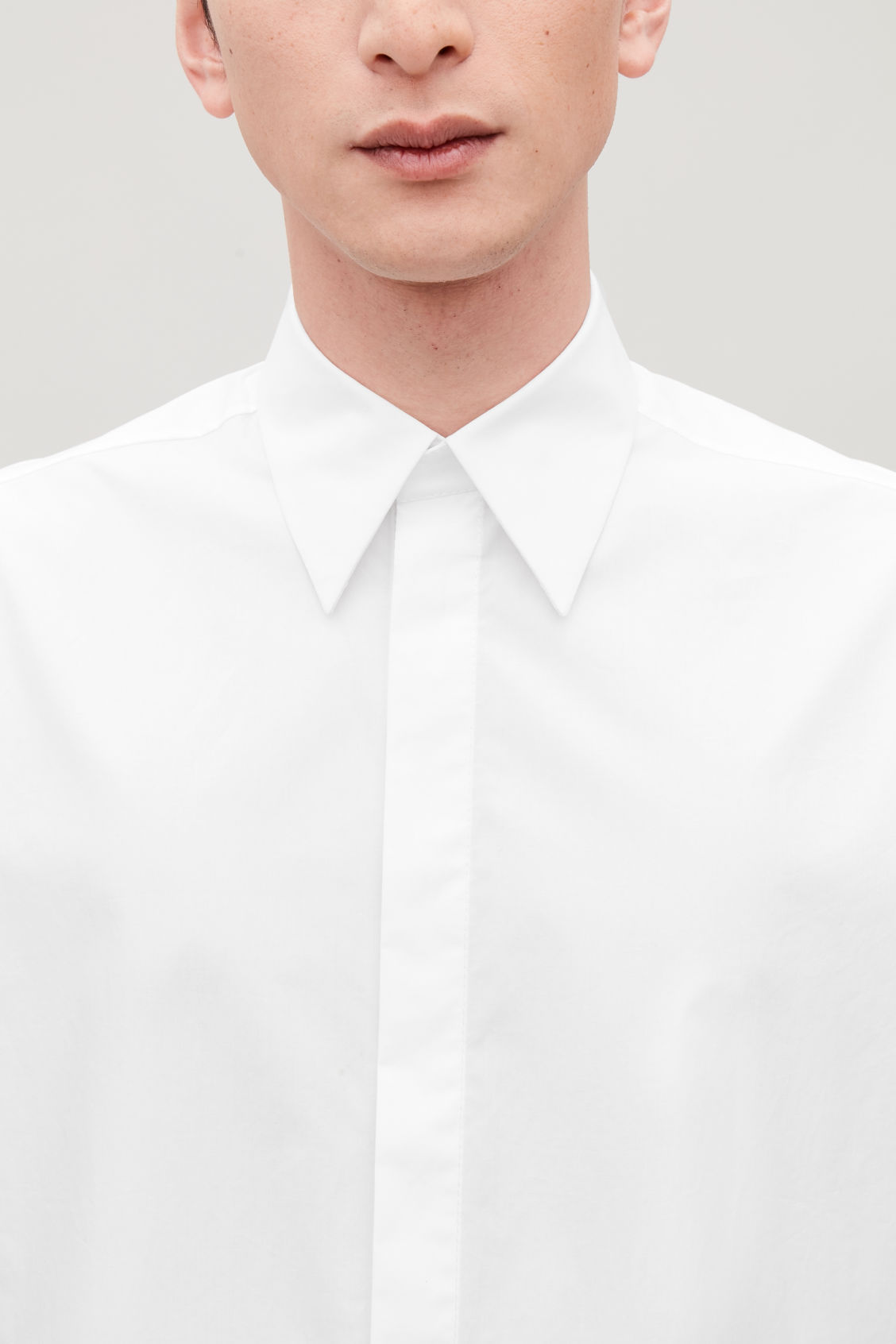 Model side image of Cos concealed-button cotton shirt in white