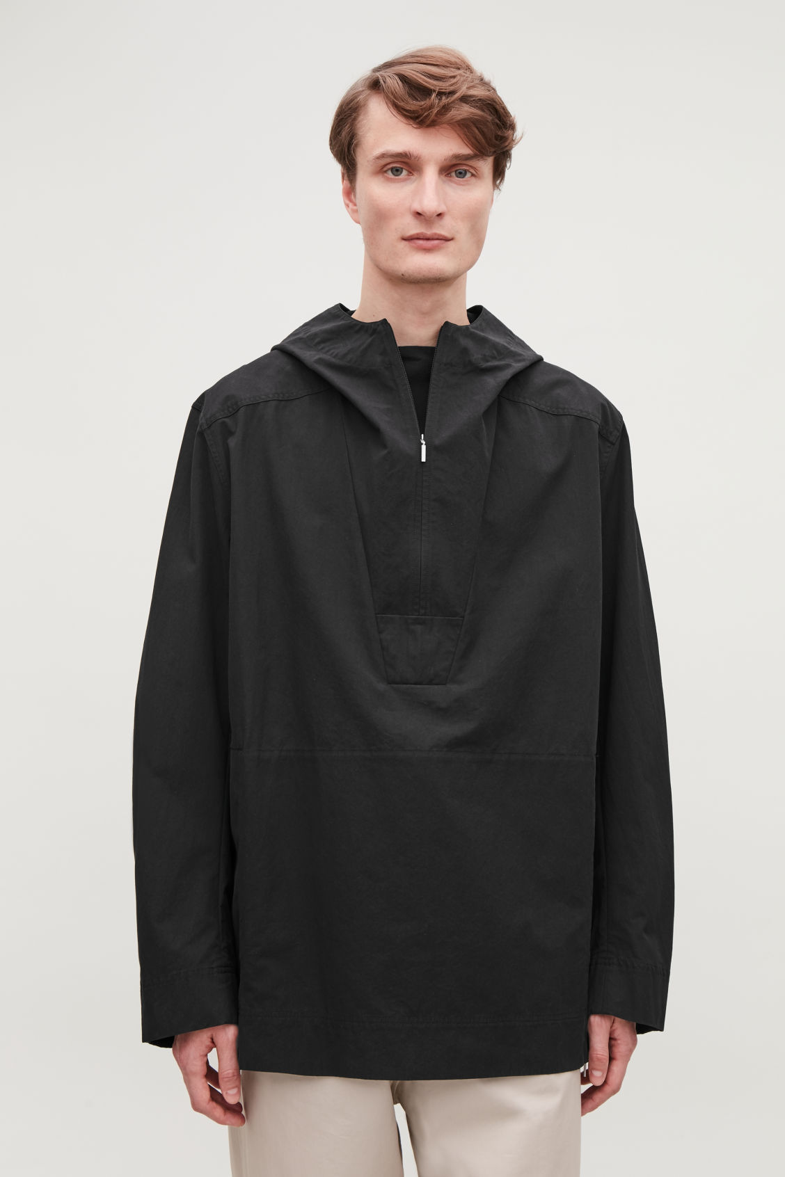 Model side image of Cos lightweight pullover jacket  in black