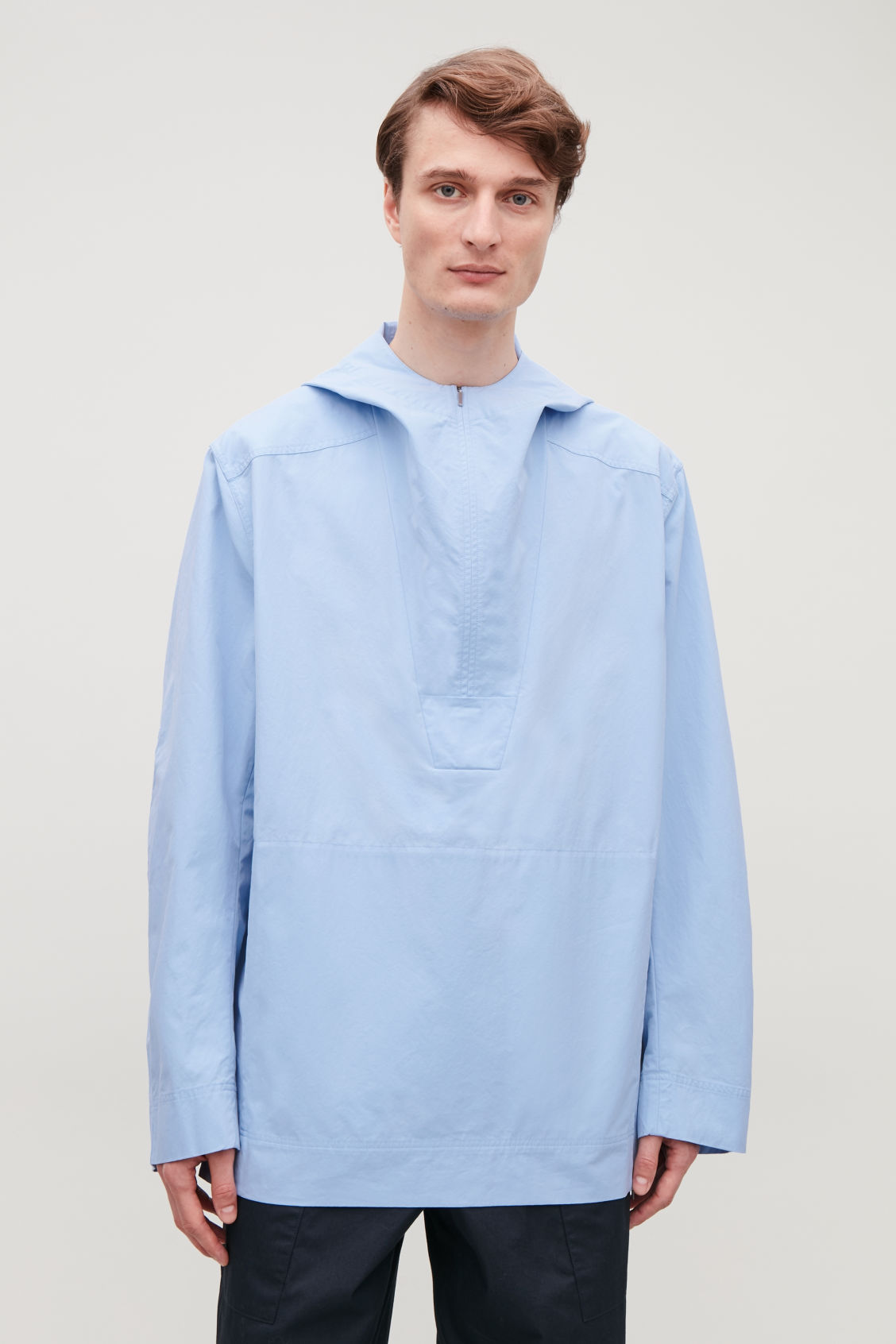 Model side image of Cos lightweight pullover jacket  in blue