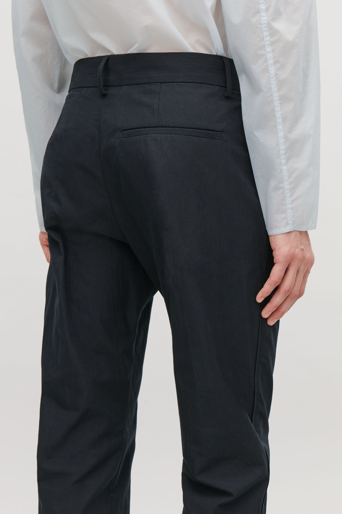 Model side image of Cos slim chinos with seam stitching in blue