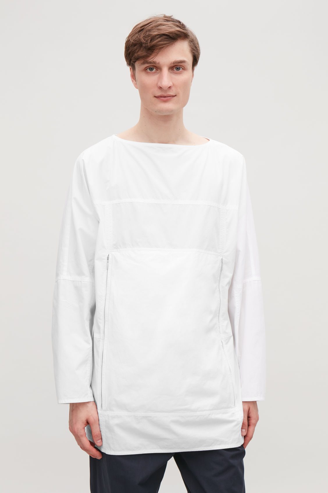 Model side image of Cos packable pullover shirt in white