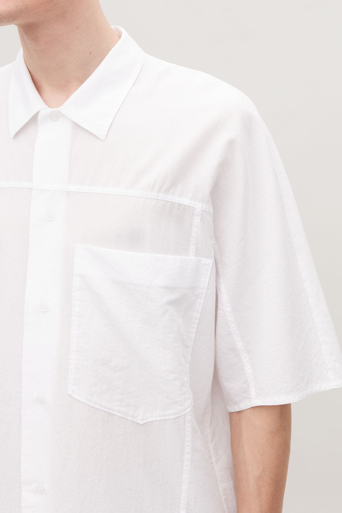 Model side image of Cos oversized light cotton shirt in white