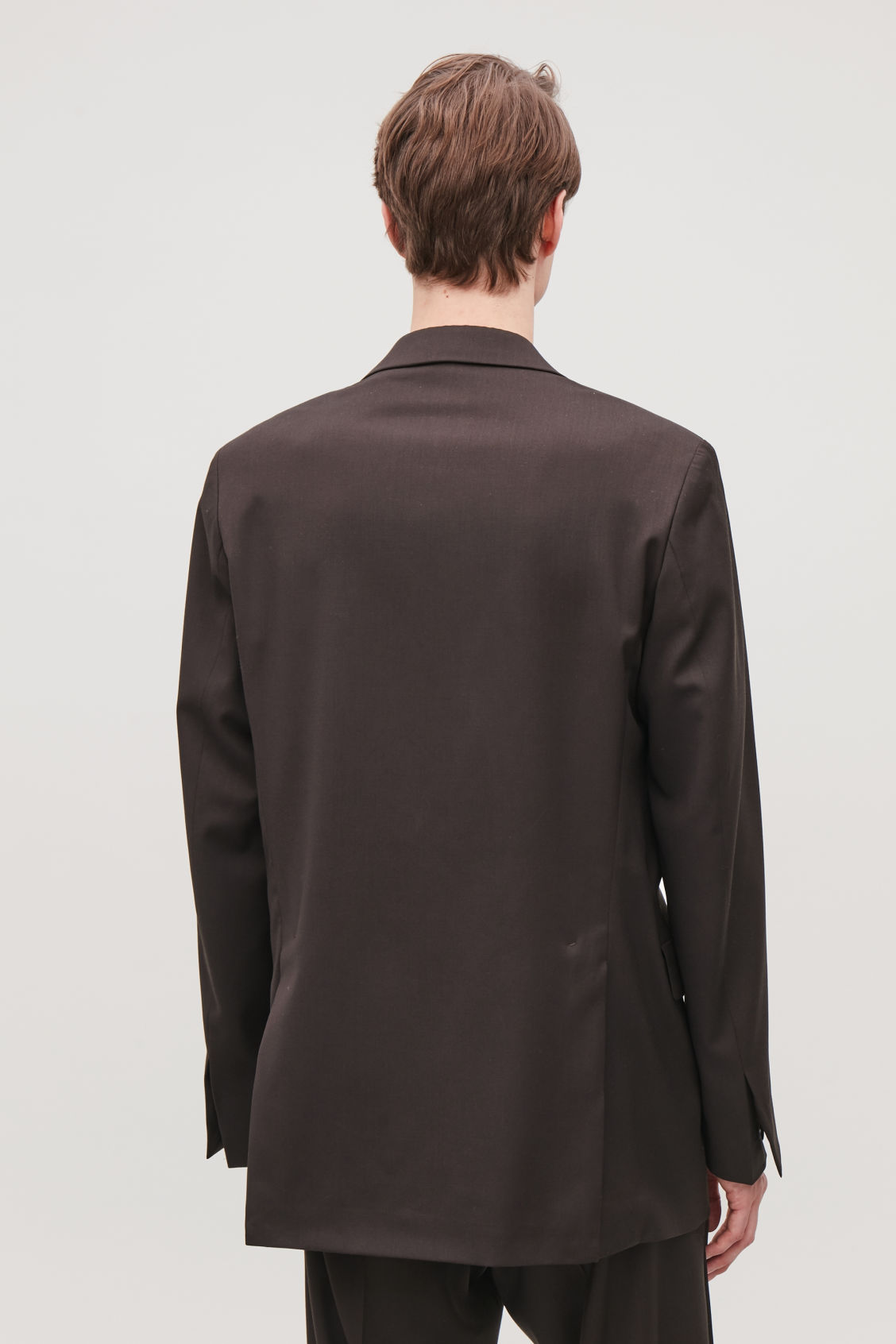 Model side image of Cos relaxed blazer with hidden buttons in brown