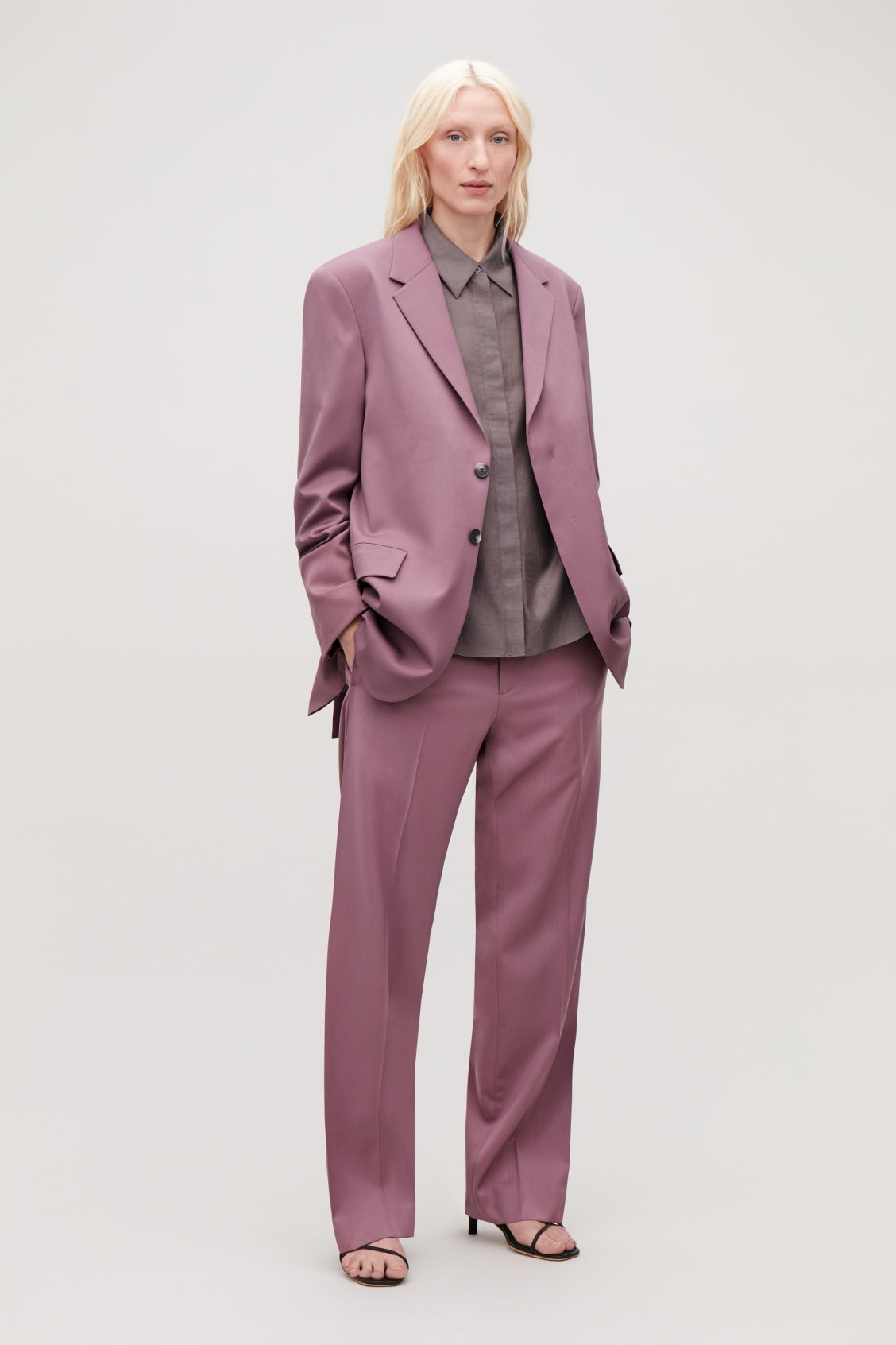 Model side image of Cos relaxed blazer with hidden buttons in purple