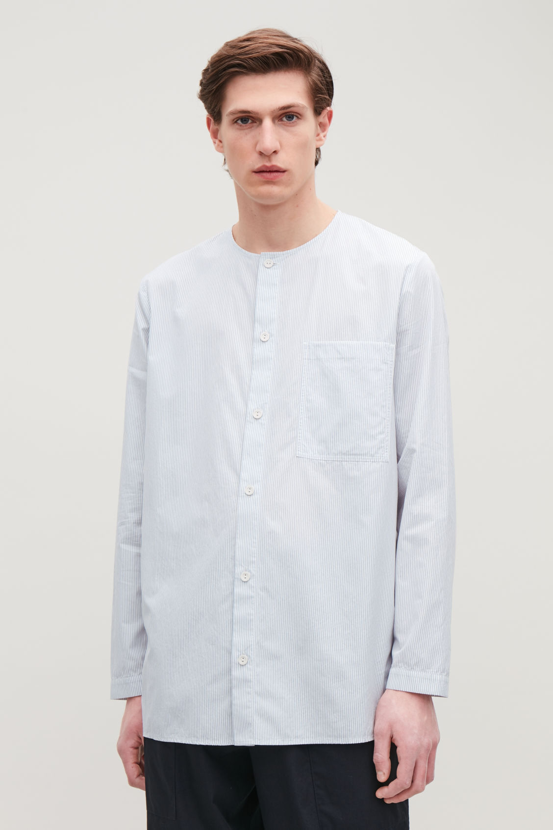 Model side image of Cos tunic-style striped shirt  in white