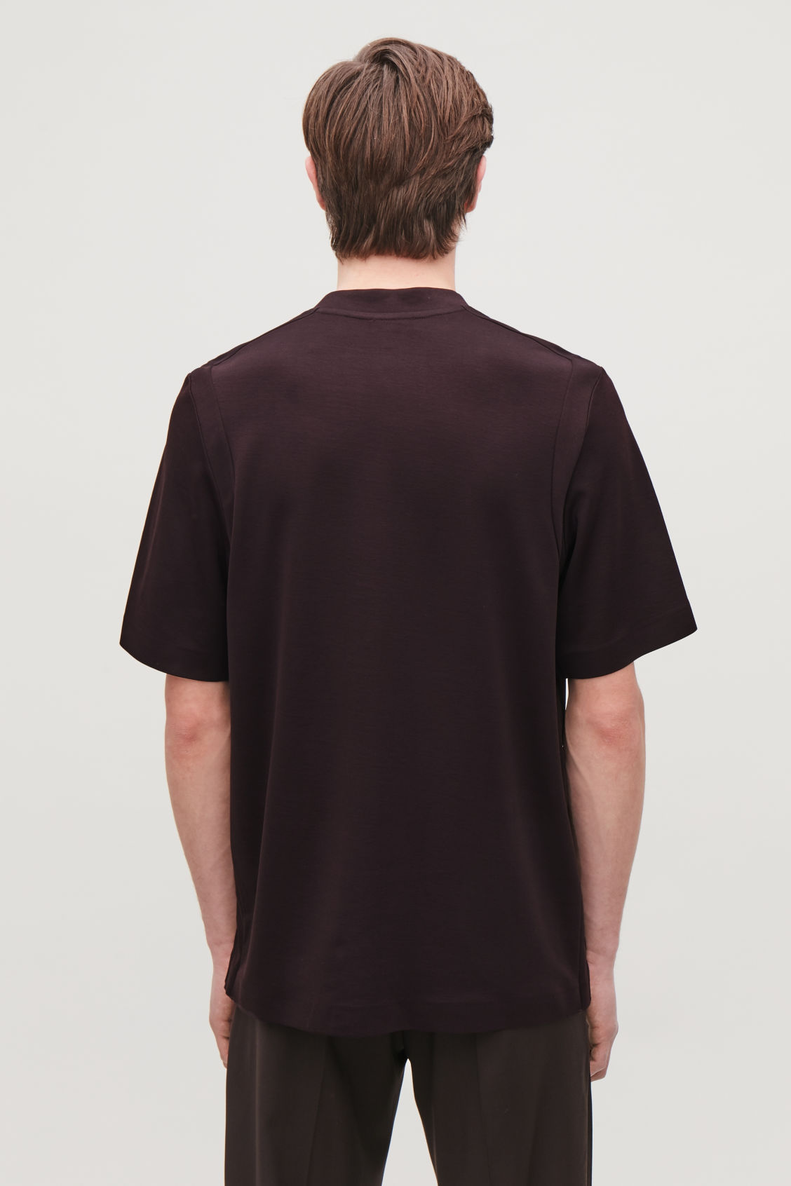 Model side image of Cos jersey t-shirt with seam covers in brown