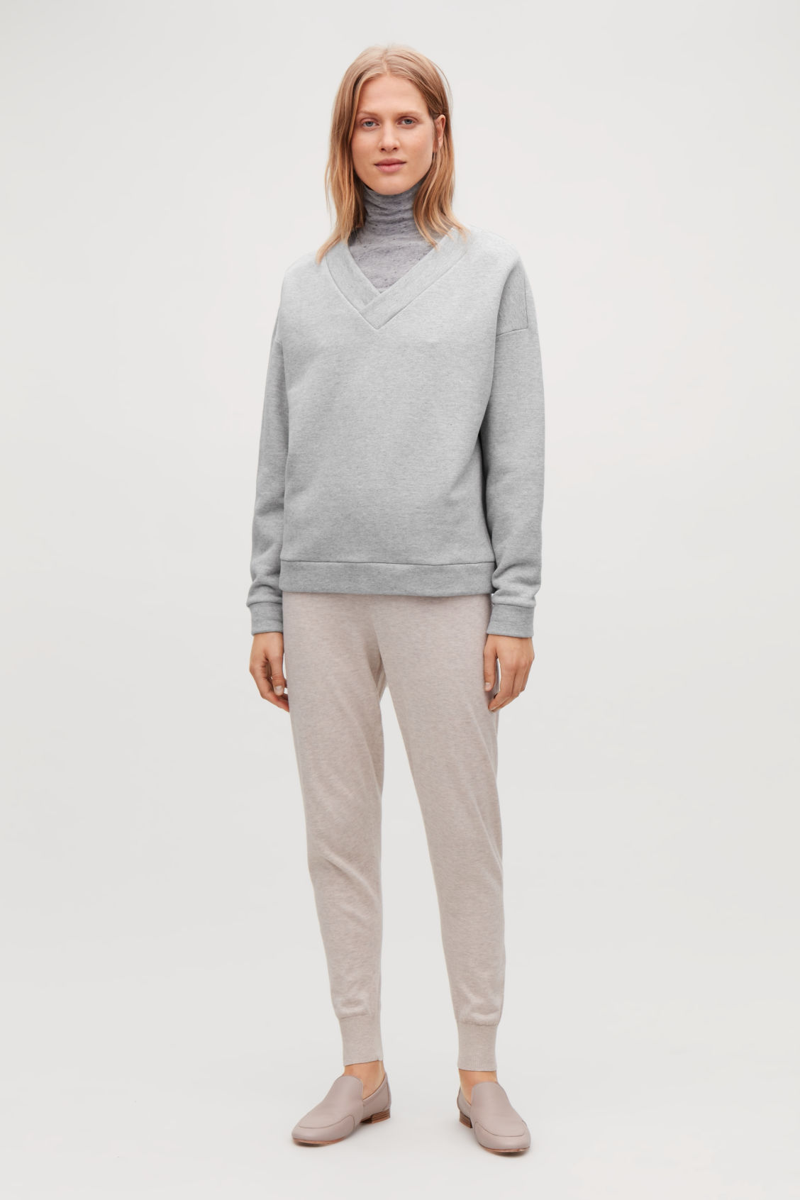 Model front image of Cos v-neck jersey sweatshirt in grey