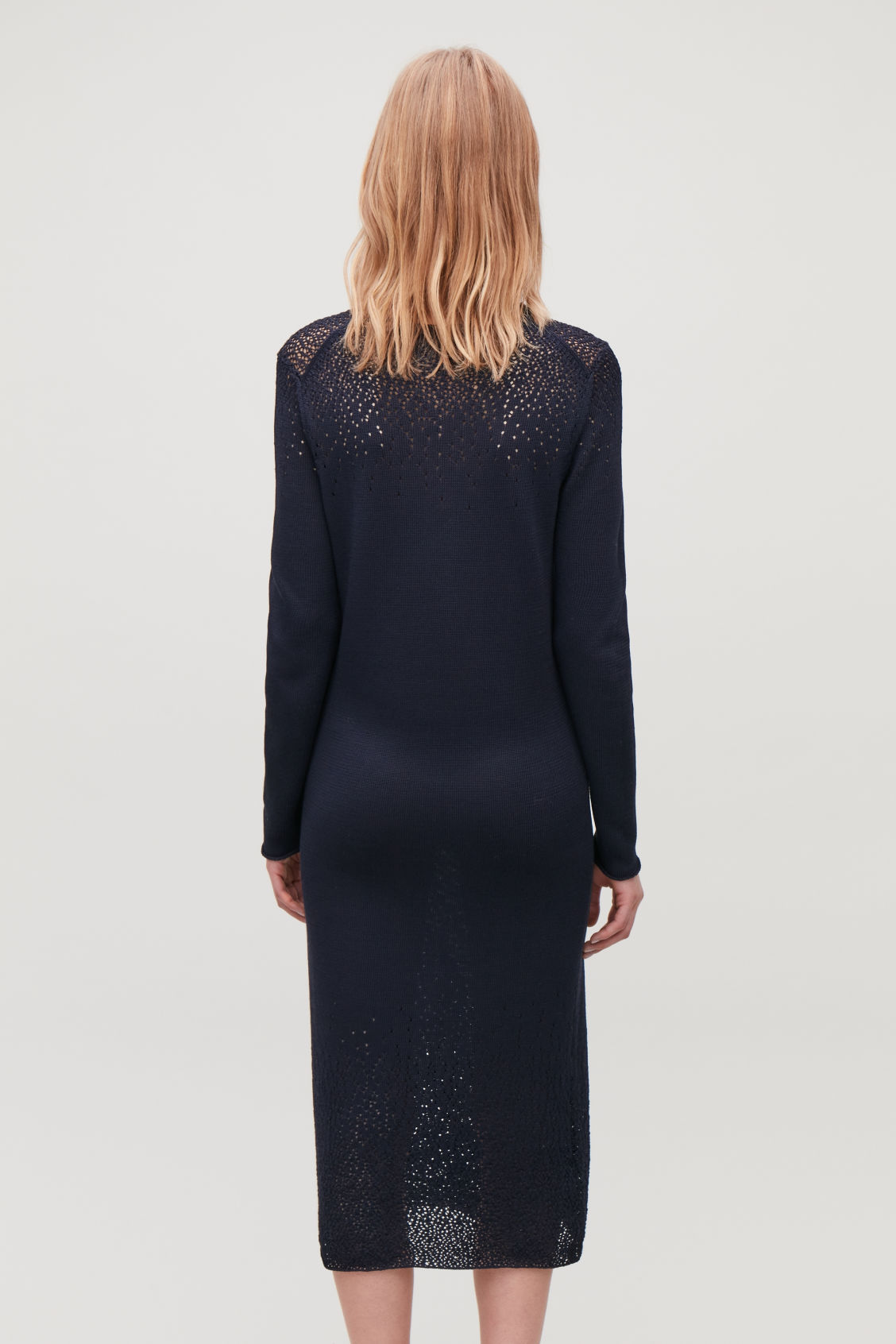 Model side image of Cos gradual pointelle-knit dress in blue