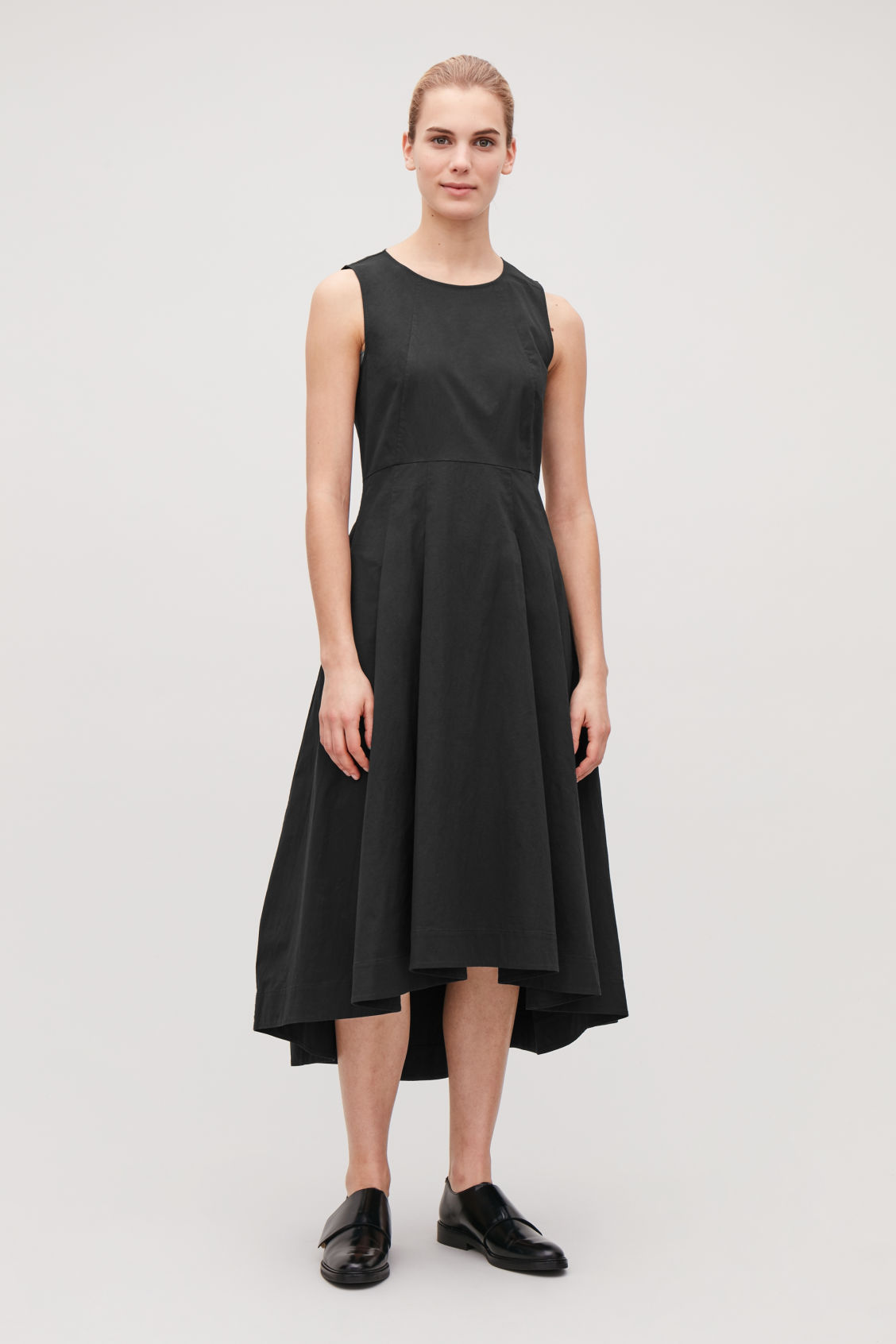 Model front image of Cos waisted dress with pleats  in black
