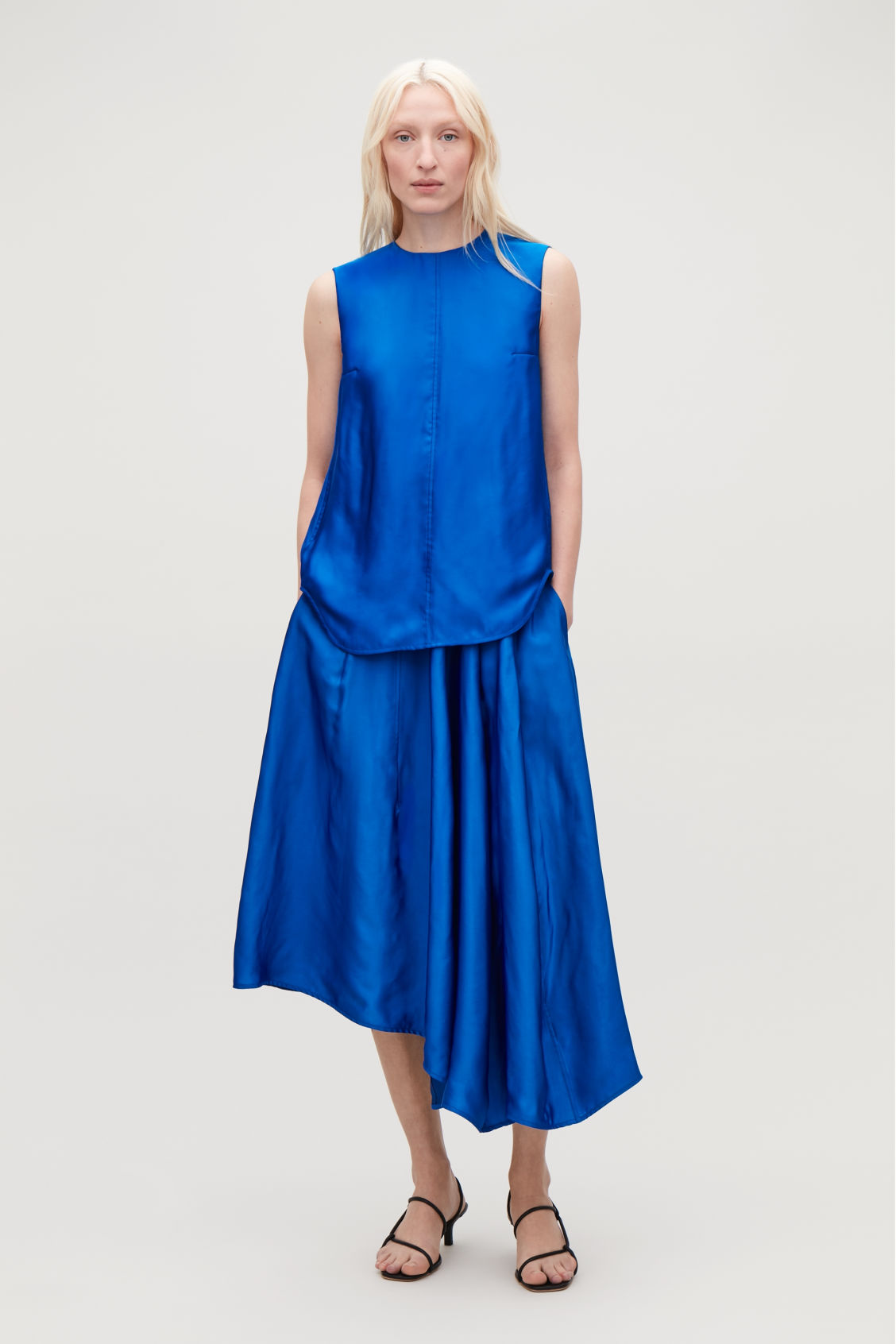 Model side image of Cos topstitched asymmetric skirt in blue