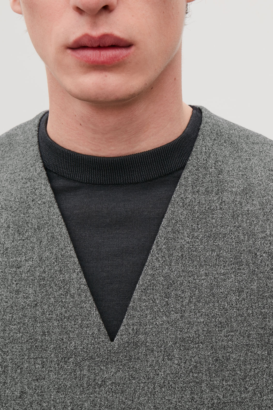Model side image of Cos woven v-neck vest in grey