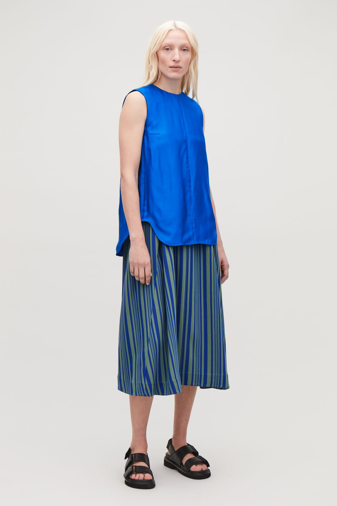 Model front image of Cos topstitched sleeveless top in blue