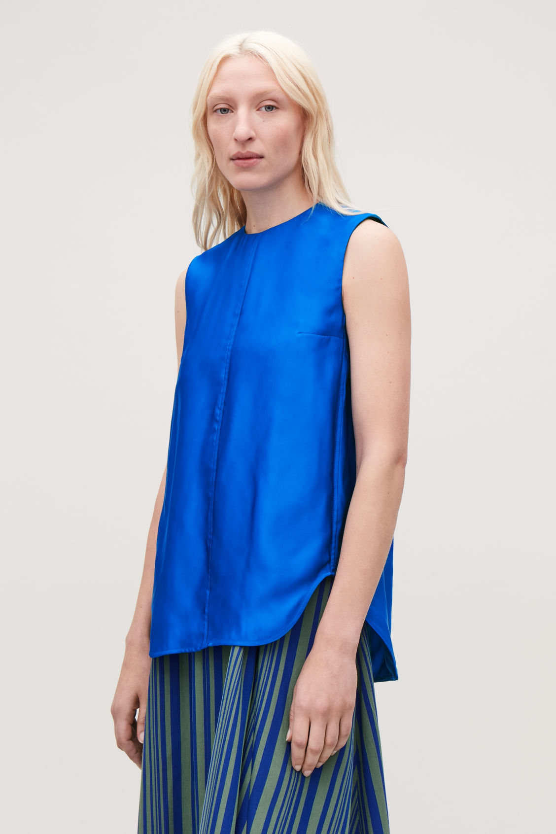 Model side image of Cos topstitched sleeveless top in blue