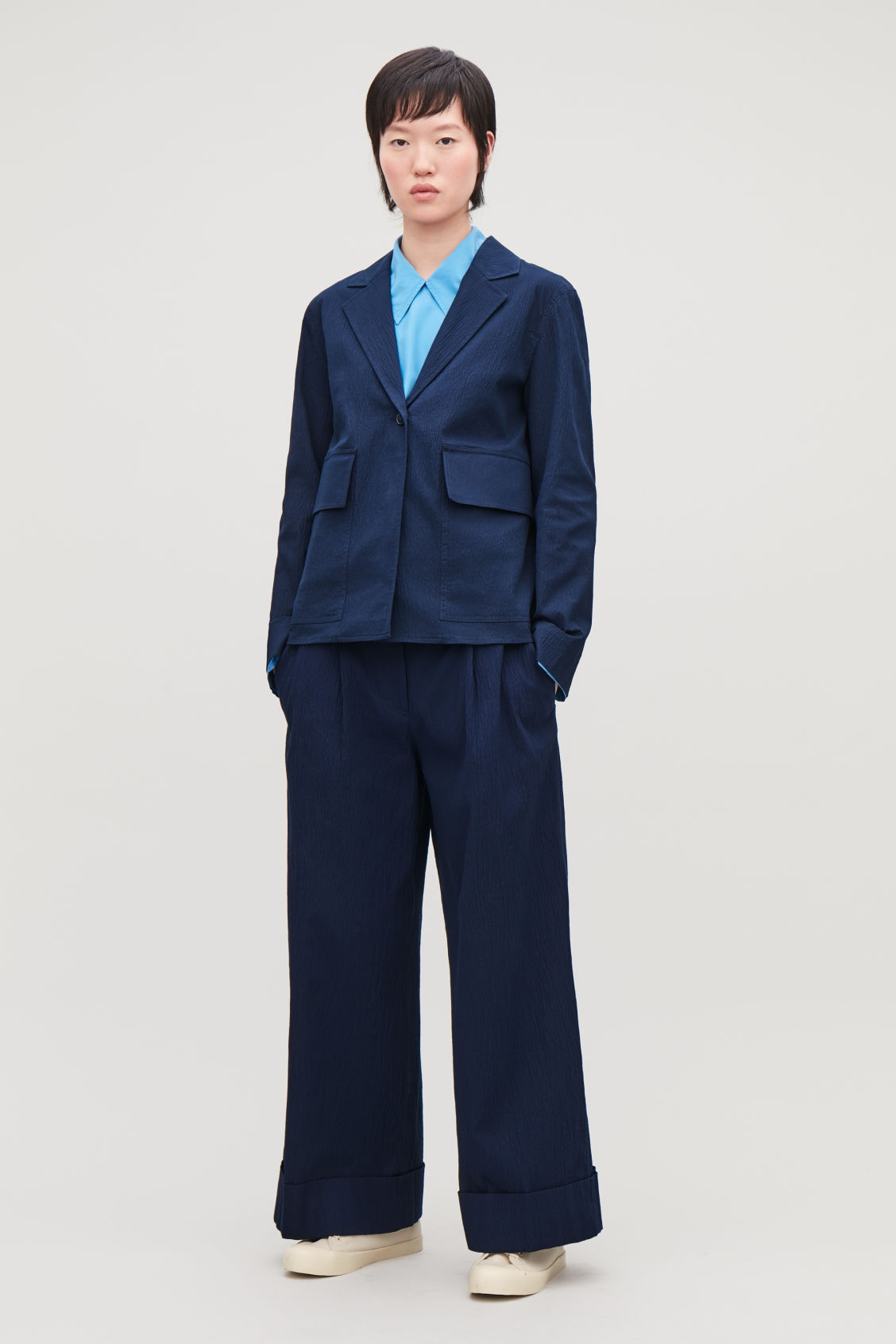 Model front image of Cos wide-leg seersucker trousers in blue