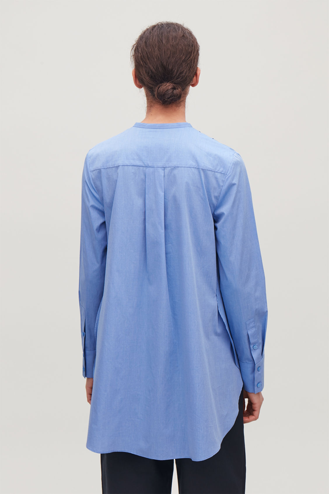 Model side image of Cos pleated-front cotton shirt  in blue