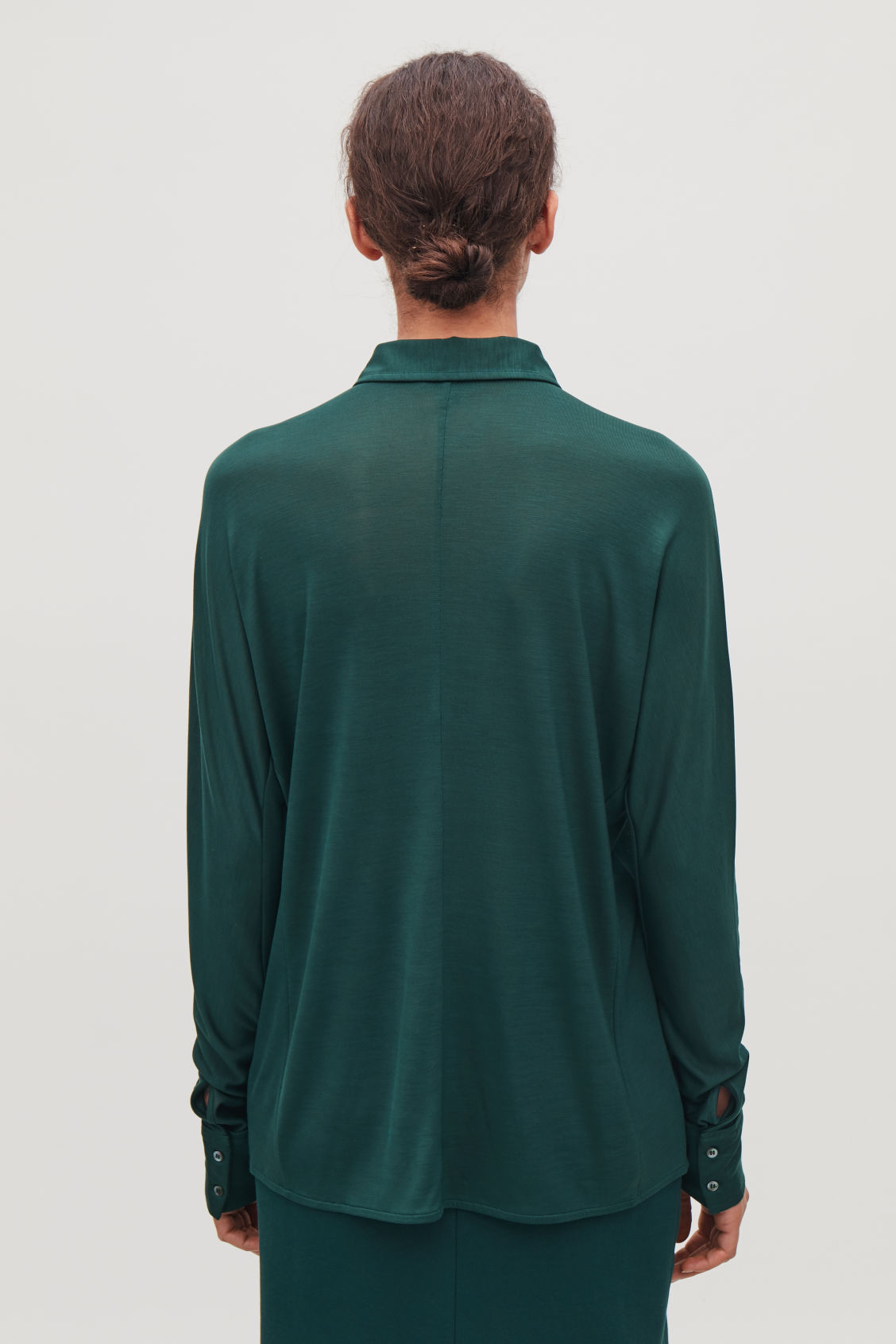Model side image of Cos batwing-sleeved jersey shirt in green