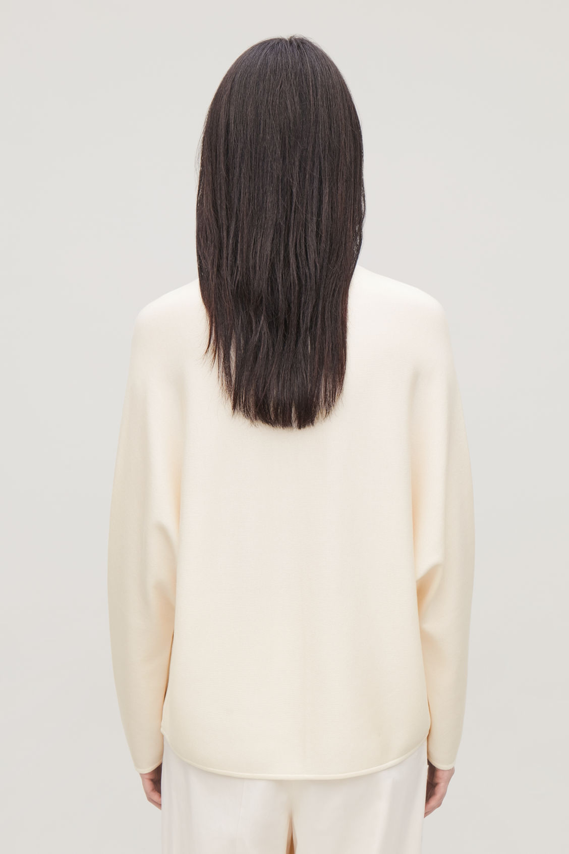 Model side image of Cos draped knit top in yellow