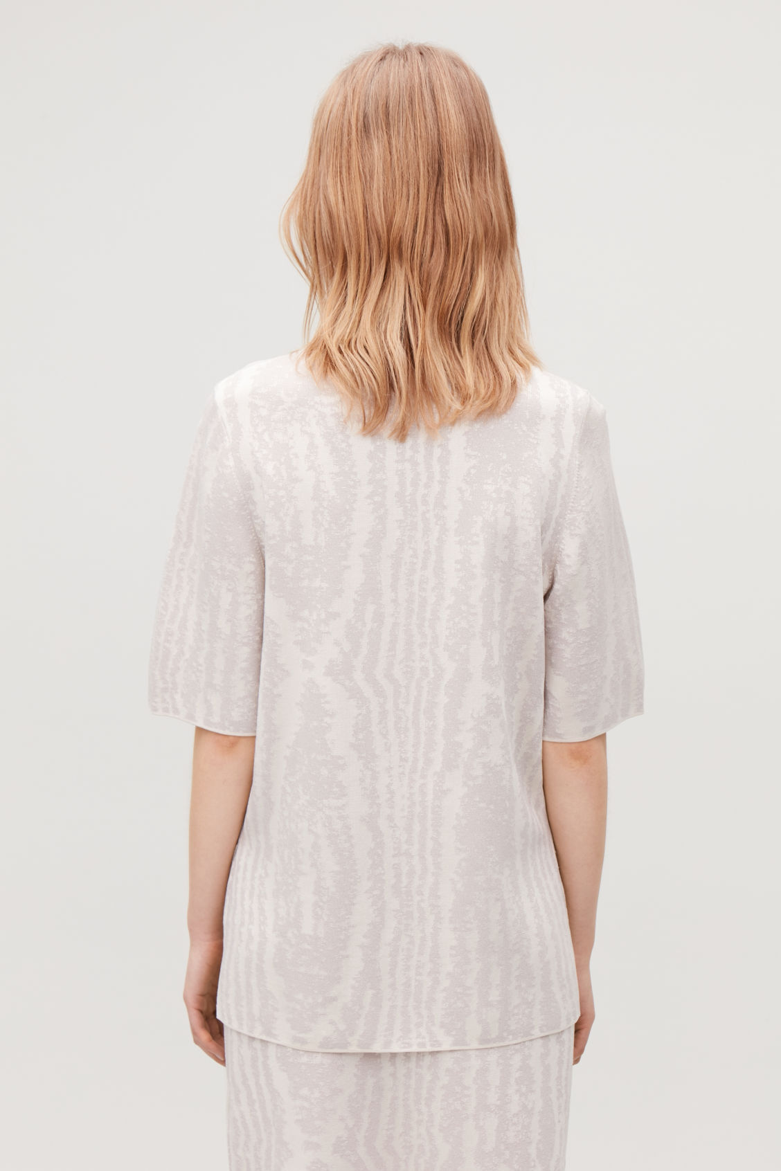 Model side image of Cos moire jacquard-knit top in beige